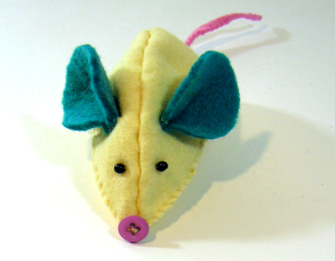 attach mouse eyes and nose felt craft