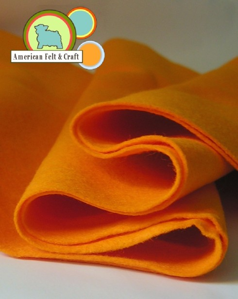 Wool blend felt by the yard, shown here in Orange Juice.