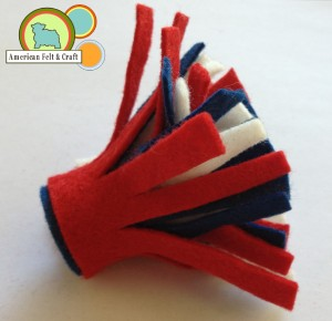 Roll up felt to create firecracker