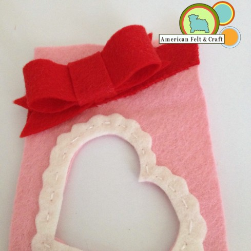 Add ribbon to front of felt valentines day box