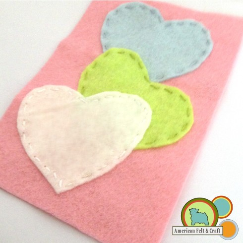 Sew hearts to back of felt valentine