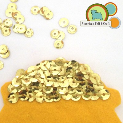 Sew Sequins onto top of gold felt piece