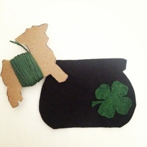 Sew shamrock onto felt piece