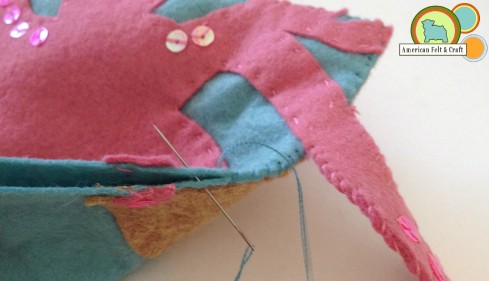 Sew felt sides together.