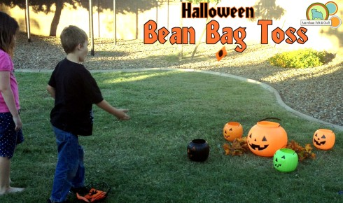 Halloween bean bag toss game with plastic pumpkins