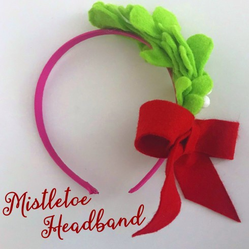 0e99abff1e762 Collect kisses this holiday with a surprisingly stylish felt mistletoe  headband. Our mistletoe headband has a decidedly vintage feel played out in  a spunky ...